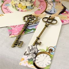 Truly Alice 'Curious' Keys & Tags - as the party favors. hang them from something on ribbons, all lengths, so there is a mass of them? from what, though? and they have to be easy for people to grab and take with them.