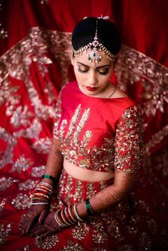 Matha Patti - Bride in a Red High Neck Choli | WedMeGood | Red Bridal Lehenga with SIlver Embroidery and Silver Matha Patti with Maang Tikka and Hanging Emeralds and Pearls  #wedmegood #indianbride #indianwedding #bridal #lehenga #silver #embroidered #choli #indianlehenga #indianwear