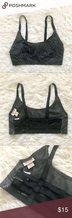 Strappy Sports Bra SZ Small This Strappy Sports Bra from Mossimo is a size small. The back of this Bra can be shown off to let others see your style! This Bra has never been worn. Mossimo Supply Co. Intimates & Sleepwear Bras