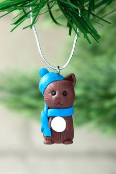 A cute hand crafted chocolate brown cat figure which would make the perfect addition to any pet lovers Christmas tree. This little kitty character is playfully holding a snowball while snuggly wearing a hat and scarf. This ornament will hang easily from y Christmas Morning, Christmas Holidays, Christmas Tree, Christmas Ornaments, Gifts For Pet Lovers, Pet Gifts, Unique Presents, Unique Gifts, Wooly Hats