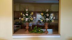 Sketo wedding arrangements and magnolia leaf accents
