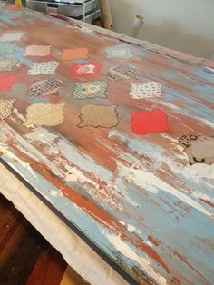 We love how the layers came out on this distressed DIY wall art. We used a hollow core door as the base, and of course, Mod Podge!