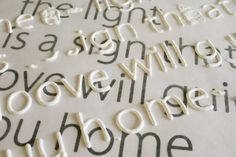 print out the font you want and place wax paper over it. Trace letters with puffy paint, let dry, then use modpodge to secure letters to canvas, etc.