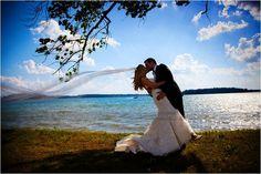 Michigan Wedding Photographers  www.ArisingImages.com  lakeside bride and groom