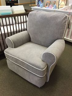 Best Chairs Quinn Swivel Glider in Mist with White piping Stock