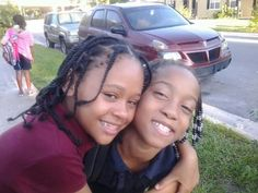 Lynnette and Jakaya at the bus stop