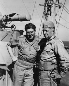 Vice Admiral H. Kent Hewitt (right), who commanded American naval forces during the invasions of Morocco, Sicily, and Salerno, on the deck o...