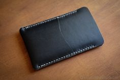 A simple sleeve case with a card pocket for iPhone 7 and iPhone 6. Handstitched Horween leather. It will age and patina gorgeously.  This sleeve is sized for a bare iPhone, with no additional case. See more iPhone and iPad products here: http://onestarleathergoods.com/products/#/iphone-ipad/  This is a genuine 100% handmade-in-the-USA product. No sewing machines, no assembly lines. Just top quality raw materials put together by hand. To learn more, check out Etsys feature of my shop…