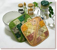 patchwork potholder that you can slip your hand into