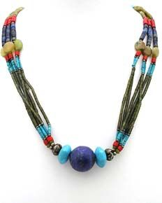 Vibrant ethnic Afghan necklace with a mouth-watering array of Lapis Lazuli, turquoise, red jasper, green and yellow jade threaded onto a six strand necklace with a central lapis bead. This lovely tribal necklace has shepherds crook fastening and is truly eye-catching.