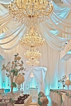 Love the draping and chandeliers
