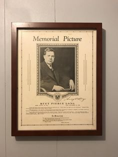 A 1935 Huey P. Long in memoriam picture hanging in the bathroom of a local breakfast joint
