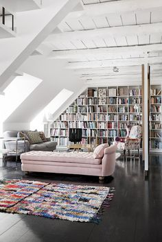 amazing bookshelves + love the pink sofa | elv's: loft love...