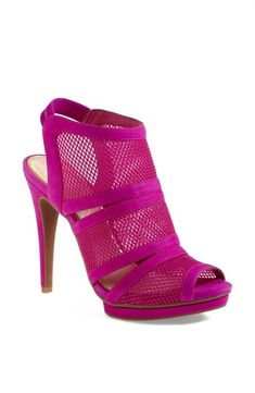 Bright pink neon caged sandal.