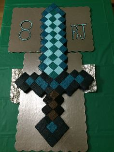 I made this minecraft diamond sword cake for my younger son who will be turning 8! Birthday party