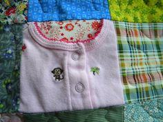 How cool. Baby clothes are stitched right into the quilt!