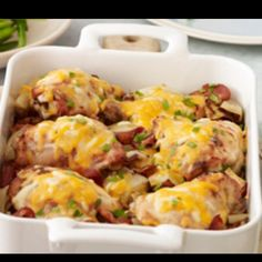 1/4 cup KRAFT Ranch Dressing 6 large bone-in chicken thighs (1-3/4 lb.), skin and visible fat removed 4 slices OSCAR MAYER Bacon 1-1/2 lb. red potatoes (about 5), cut into 1-inch chunks 1 onion, cut into 1/2-inch chunks 1 cup KRAFT Shredded Triple Cheddar Cheese with a TOUCH OF PHILADELPHIA 2 Tbsp. chopped fresh parsley  Make It Pour dressing over chicken in shallow dish. Refrigerate 30 min. to marinate. Heat oven to 400ºF. Cook bacon in large skillet on medium heat until crisp. Remove bacon…