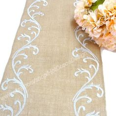 Unique wedding table runner made of natural burlap embroidered with vintage shimmering silver, silk and metallic ,French inspired embroidery.  Sise: 14 wide Please select the length at the drop down menu.  All my runners edges are overlocked (serged) and will not unravel.  If you are looking for a different size, please let me know and I will be happy to customize the runner in the size you are requesting.  Matching silverware pockets available upon request.  THANK YOU FOR YOUR ATTENTION! DO…
