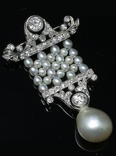 Natural pearl and diamond brooch, French or English, 1920s. Natural pearls, old European-cut diamonds, platinum.