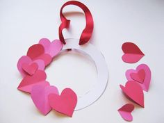 How to Make a Valentine's Day Heart Wreath: Glue your hearts onto the wreath base. Put childs photo in middle