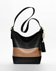 23d69a9a6e54 Coach camel and black Purses And Handbags