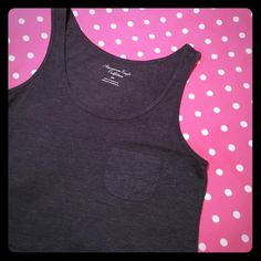 "American Eagle cropped tank Charcoal gray cropped tank with cute pocket on the chest. Excellent used condition, no signs of wear. Bust lying flat: 17"", front length: 17.5"", back length: 19"" American Eagle Outfitters Tops Crop Tops"
