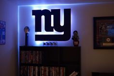 Any football fan whose favorite team is the Giants will enjoy this New York Football Giants Wood Cutout! This cutout has red edges with a Giants blue face.  The perfect accessory for your husband's New York Giants Man  Cave!  www.addcitedfurnishings.com