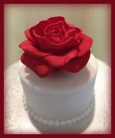 Fondant-covered cake with large sugar paste rose