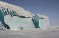 Striped icebergs of the Antarctic form when the ice sheets from which bergs are formed pick up layers of sediment