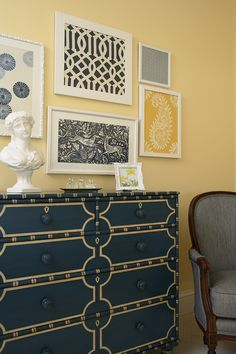 I like this vignette.  Especially the starburst paper on the left and the asian-but-not-really painted dresser.