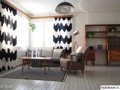 olohuone,kulmaikkunat,matto,anno,lokki