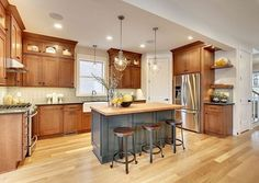 Oak Cabinets with white trim. Toasted oak cabinets paired with charcoal grey and white oak floors and butcher block island. Wood Floor Kitchen, Kitchen Paint, Kitchen Redo, Kitchen Flooring, New Kitchen, Kitchen Tile, Awesome Kitchen, Design Kitchen, Kitchen With Corner Pantry