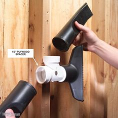 Take one of your shop vacuum attachments to the home center and find a PVC tee that fits. Drill a hole in the tee large enough to accept a screwdriver, place a small plywood spacer behind it and screw it to the wall.