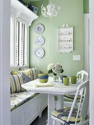 Mint green kitchen, lots of white and mix of stripes and prints. Like the vertical placement of blue and white plates.