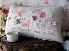 The wording on this pillow can be customized to include any phrase or saying....and may include a persons name.  A precious gift for Mothers Day! This hand-made muslin needlework pillow, with soft pinks and whites, celebrates a mothers love! Send a smile to someone special with this high-quality pillow. Size is approximately 16 x 8.