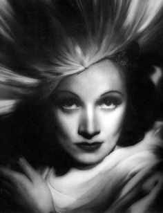 George Hurrell - Marlene Dietrich (1938).  Looking like a goddess in this one.  While she was in London, officials of the Nazi party approached Dietrich and offered her lucrative contracts, should she agree to return to Germany as a foremost film star in the Third Reich. She refused their offers and applied for US citizenship in 1937, receiving it in 1939.