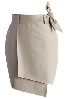 This is a Faux Leather Skirt. If you have an old pencil skirt requiring an update, this might be a good idea. Uneven bottom and a bow on the waist. Simple to do, pretty to look at.