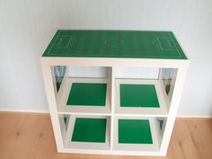 new idea for kids Lego workstation - very cute! You could even use the bottom cubbies for storage bins