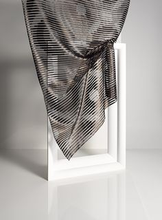 EPOCA by Ulf Moritz - Transparent fabric with a graphical design of circles in Scherli-technique.