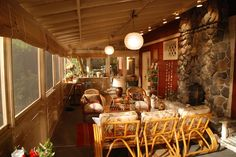 Worn-in bamboo and wicker furniture provides further lounging space for the Braverman's large extended family.