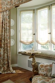 adorable window treatment for bay windows
