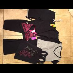 Zumba NWT bundle if 5 size S/M. #407 NWT bundle includes a pair of cargo pants size M a pair of terry shirts size S A grey shirt size S a black tank size S pink sports bra size S. Tags attached no flaws Zumba Other