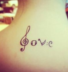 Love in music notes tattoo.