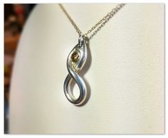 100% Pure Silver Infinity pendant holding a 0.18ct Smoky Black Cubic Zirconia gem. Hand crafted with love by me!