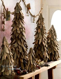 Driftwood Christmas Trees.     As seen in Coastal Living. Rustic trees hand-crafted from natural driftwood pieces, adds a natural element to your seaside Christmas decor.     Adorn them with lights, small ornaments or admire them for their simple, natural beauty. From the Driftwood Collection at SeasideInspired.com