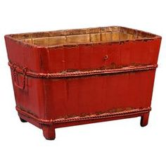 """Handmade wood sink bucket with a distressed red finish.  Product: BucketConstruction Material: WoodColor: RedFeatures: HandmadeDimensions: 10"""" H x 11"""" W x 13"""" DNote: This item has a distressed finish. Each piece will have an antiqued look all its own.Cleaning and Care: Wipe down with lemon oil for maintenance and beautiful shine"""