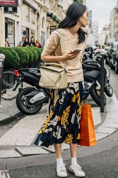 July 3, 2016  Tags Black, White, Paris, Pleated, Beige, Loewe, Yellow, Women, Prints, Model Off Duty, Models, Sneakers, Skirts, Sweaters, Puzzle Bag, 1 Person, FW16 Women's Couture