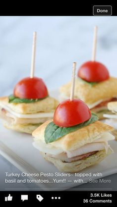 Turkey/cheese sliders with tomato and basil leaf