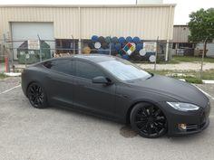 "2013 tesla model S p85+ 3m matte black. Blacked out chrome. Powder coated 21"" wheels."