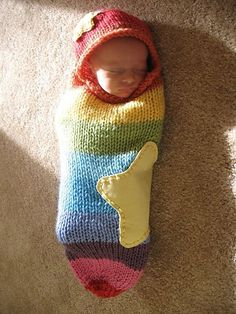 Rainbow baby cocoon, I realize this is knitted but one could use sweater scraps too and your SERGER , woo hoo
